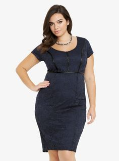 Lovely in allover floral lace, this navy dress has short sleeves and a scoop neck. With a streamlined silhouette, the darling dress has black faux leather trim on the bust and waist that gives it a chic, upscale look.%0A