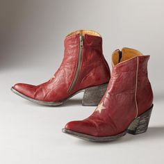 "STAR BOOTS -- Covetable crimson leather star boots from Old Gringo take center stage. A single star and sleek lines form an eye-catching combination. Leather. Imported. Whole and half sizes 6 to 10, 11. 2-3/4"" heel.View our entire Old Gringo Collection"