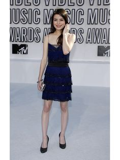 Sticking with sequins at the 2010 MTV VMA's, Miranda wears a blue tiered dress with stunning sparkly black trim.