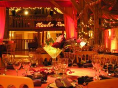 French Parisian Moulin Rouge theming at Bury Court Barn Bentley Surrey with illuminated sign, velvet draping, wall uplighters and themed table centres by www.stressfreehire.com #venuetransformers