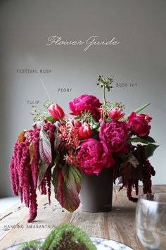 hot pinks + reds floral arrangement: peonies, amaranthus, tulips, festival bush and bush ivy
