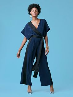 This kimono-style, 100% silk, short sleeve jumpsuit features a detachable fabric belt and contrasting-colored panels that add depth to this roomy and sleek wardrobe staple.