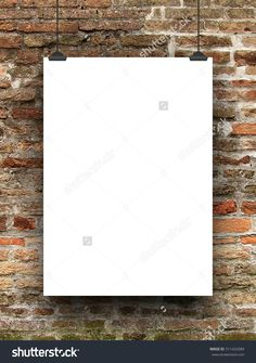 Single blank frame hanged by clips against old weathered brick wall background