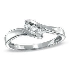 1/6 CT. T.W. Diamond Three Stone Bypass Ring in Sterling Silver