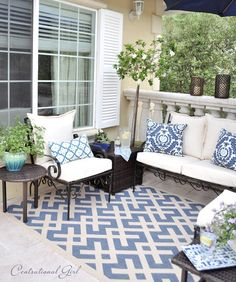 Use an outdoor rug to anchor backyard furniture