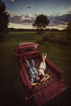 Red truck. Bed lounging