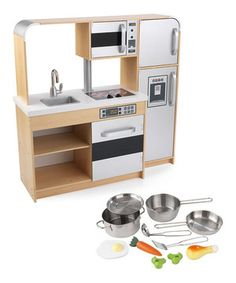 Young chefs serve the best dishes from this interactive play kitchen and cookware set. Featuring an easily cleaned removable sink, appliances with knobs that turn and click, and doors that open and close, this kitchen invites multiple children to cook together in an exciting and educational environment. Plus, the metal pots and pans and food accessories allow little ones to make pretend mouthwatering meals.