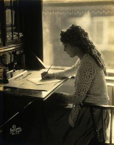 Mary Pickford by Hartsook Photo, 1918    Actress Mary Pickford writing at a desk, by Hartsook Photo Studio, San Francisco & Los Angeles, California, 23 March 1918.