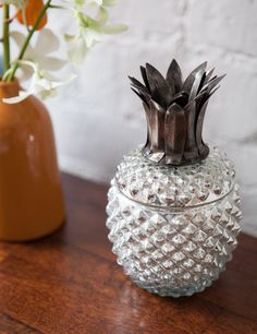 We love this kitsch silvered glass trinket box in the shape of a pineapple.