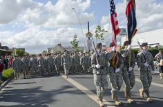 Soldiers from the 101st Airborne Division, along with allied troops from multiple countries, participate in a parade through the streets of Carentan, France, June 4, 2014. The town is hosting several events commemorating the 70th anniversary of D-Day operations conducted during World War II. U.S. Army photo by Sgt. A.M. LaVey, 173rd Airborne Brigade Public Affairs