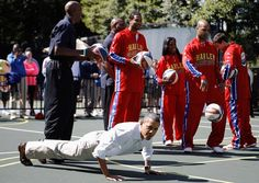 It's not every day you see one of the most powerful people in the world doing this. President Obama proved he takes wife Michelle Obama's message on how important fitness is seriously when he knocked out a bunch of pushups in front of the Harlem Globe Trotters on Monday. The team was there to participate in the White House's Easter Egg Roll. (4/9/2012)