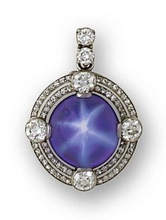 An art deco star sapphire and diamond pendant/brooch, circa 1930 centering
