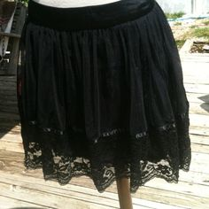 """XXI black skater lace skirt small flirty & fun This super cute mini skirt has soft lace accents .. Small size .. Like new condition 18"""" from waist to hem-15"""" waist measures 15"""" side to side flat Forever 21 Skirts"""