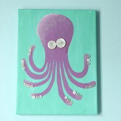 Turn a blank canvas into whimsical octopus art with acrylic paint, glitter and buttons for tentacles!
