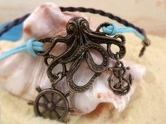 Anchor Bracelet - Kraken Steampunk Octopus Bracelet by ZodiacGirls, $7.49 Black braid and turquoise... especially cute if you add the Dead Pirate charm for just a buck more!
