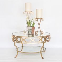 e with the Treillage Coffee Tablefrom Wolrds Away!This modern two tiered, round tablewith glass shelves creates a stunning focal point for table top favorites.A bottom sh