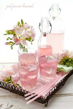 Pretty bottles of pink lemonade!  Freeze pink lemonade in ice cube trays ahead of time, so the ice cubes don't dilute the beverages.      #pink #lemonade #party