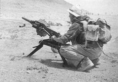 """VDV soldier firing what looks like a """"Balkan"""" 40mm automatic grenade launcher. Somewhere in Afghanistan, late 80s."""
