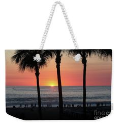Crowd At Sunset Weekender Tote Bag  by Gravityx9 Designs.  The tote bag is machine washable and includes cotton rope handle for easy carrying on your shoulder.  All totes are available for worldwide shipping and include a money-back guarantee.  at Pixels and FineArtAmerica