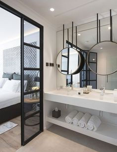 Mirror layered on top of mirror. Bathroom with a marble floating vanity at Hotel The Serras in Barcelona, via @sarahsarna.