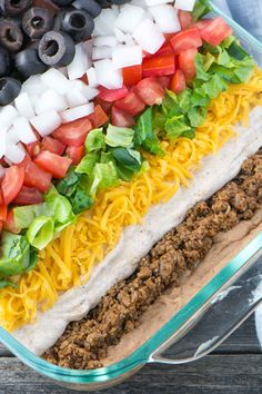 How to Make The Best 7 Layer Dip - Simple Revisions Mexican 7 Layer Taco Dip is a fully customizable appetizer with seasoned beef, refried beans, three types of cheeses, and loaded with your favorite toppings. Mexican Dip Recipes, Mexican Dips, Mexican Appetizers, Appetizer Dips, Appetizer Recipes, Appetizers Superbowl, Salad Recipes, Bean Dip Recipes, Mexican Party