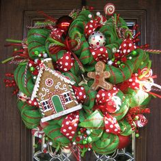 This 26 deluxe mesh wreath is fun with its GINGERBREAD theme! It features a gingerbread house, gingerbread man, candies and lots of other colorful accents