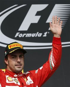 Ferrari driver Fernando Alonso of Spain greets spectators after placing second in the Hungarian Formula One Grand Prix in Budapest, Hungary, Sunday, July 27, 2014. Hamilton placed third in the race. (AP Photo/Darko Vojinovic) ▼27Jul2014AP|Red Bull's Ricciardo wins Hungarian Grand Prix http://bigstory.ap.org/article/red-bulls-ricciardo-wins-hungarian-gp-alonso-2nd