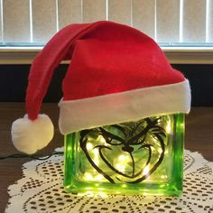 Grinch Glass Block with green lights. This block measures The glass block is decorated on both sides with two different Grinch faces so you can enjoy this from any direction. Grinch Christmas Decorations, Grinch Ornaments, Grinch Christmas Party, Christmas Wood Crafts, Christmas Signs, Christmas Projects, Holiday Crafts, Grinch Party, Tree Decorations