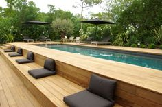 modern landscaping Above ground pool ideas to beautify a prefab swimming pool and give it a custom look. Ideas include above ground pool decks, modern landscaping and siding.