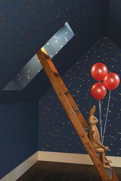 Midnight blue and metallic gold star wallpaper.