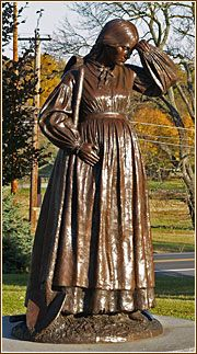 "Gettysburg, PA: ""Life-size sculpture honoring Elizabeth Thorn, who was six months pregnant when she dug graves and buried 102 bodies after the battle. Most of her belongings were also destroyed during the battle, since her home, like all available structures, was used to house wounded soldiers. ""Her baby girl was born in the fall, small and weak. Elizabeth said she never regained her full health after the battle of Gettysburg and its aftermath."""