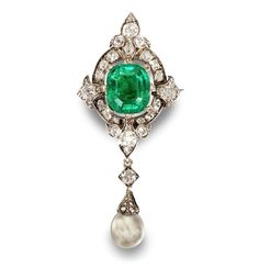 A 19th century emerald, diamond and natural pearl brooch/pendant The cushion-shaped mixed-cut emerald, weighing 7.15 carats, within a quatrefoil border of cushion-shaped, old brilliant and rose-cut diamonds, suspending a drop-shaped pearl, measuring 8.91 by 10.27mm, with rose-cut diamond cap, mounted in silver and gold, remaining diamonds approximately 2.40 carats total, length 6.2cm, cased by D. & J. Wellby Ltd, Garrick Street, London.