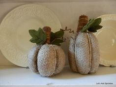 Pumpkins in burlap..... I especially love the tall skinny one!   Let's Add Sprinkles