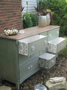 Chalk paint dresser with patterned wall paper drawers