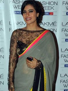 bd0b920c34042 Kajol  Kajol looks stunning is a black lace full-sleeved blouse which she  has