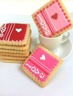 Love Stamp cookies - these will go perfectly with the idea I pinned on making envelope cookies to go in the little red mailboxes from Target ~ Am