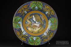 A Cantagalli maiolica charger in Deruta style, decorated with central design of…