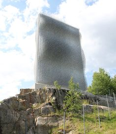 in the norwegian town of askim, local studio handegård arkitektur has realized a roadside landmark that spans nearly 6 storeys above passing pedestrians and cars.