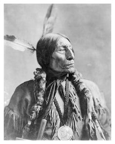 Southern Cheyenne Chief Wolf Robe. The chief is wearing a Benjamin Harrison Peace Medal circa 1904