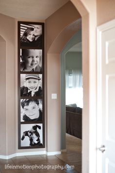 pictures stacked vertically at end of hallway to look like photobooth picture strip...Love.
