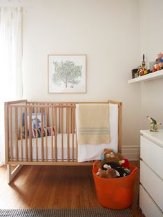Cute gender neutral nursery with natural wood crib