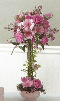 Free Centerpiece Tutorials; Check out step by step instructions for corsages,  bridal bouquets, altar sprays, candelabras and more.