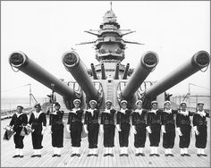 Vintage photographs of battleships, battlecruisers and cruisers.: Crew standing at attention in front of the superfi...