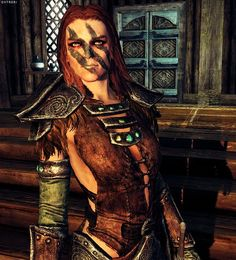 Aela the Huntress from Skyrim. Good closeup of her woad, chest piece, and makeup