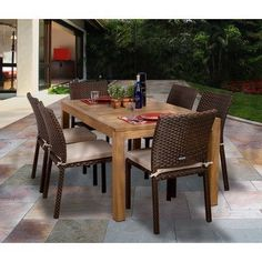 Amazonia Brownsville 7 Piece Dining Set by International Home Miami. $1349.00. SC Rinja_Liberside Features: -Material: Teak wood, aluminum and synthetic wicker.-Contemporary style.-Free feron gard vinyl preservative for longest strap durability.-Works great against the effects of air pollution salt air and mildew growth. Includes: -Set includes dining table and six side chairs with cushions. Assembly Instructions: -Some assembly required. Dimensions: -Table dimensio...