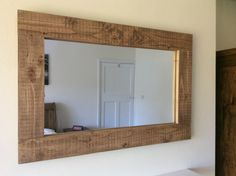 You are viewing my handcrafted rustic mirror. The mirror is constructed from solid reclaimed pine and finished in a coloured oak wax. Sizing - there is a variety of size options available ranging from: WIDTH - 90cm , 100cm , 110cm , 120cm , 130cm , 140cm , 150cm , 160cm ,
