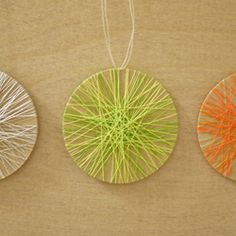 Create contemporary string art ornaments using balsa wood and colorful thread.