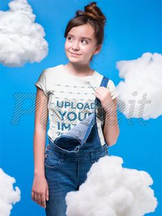 dd5162cdc4 Mockup of a Girl Wearing a Round Neck T-Shirt Mockup in a Room with Clouds  a19578