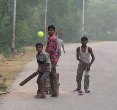 Indian boys playing tennis ball cricket on the street in Uttar Pradesh, India. Kids Around The World, We Are The World, India Street, Indian Boy, Science Articles, Boys Playing, Sport Man, Outdoor Play, Science And Technology