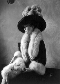 Louise Cromwell poses in fox furs, c. 1911. This is likely the wealthy heiress who married General Douglas MacArthur on February 14, 1922.